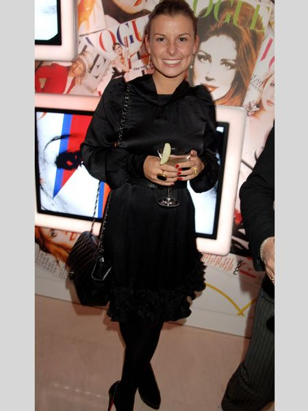 <p>Another tres chic outfit choice - the combination of satin, ruffles and quilted textures ensured this all-black look was far from dull</p>