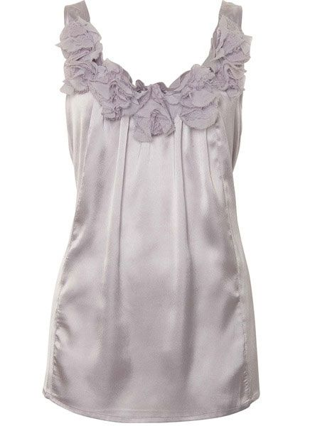 "<p>Sheer tones are packing a  punch on high street right now, the colour and the neck frill detail on      this vest is a sure fire winner</p>  <p>£25<a target=""_blank"" href=""http://www.awear.com/going-out-tops/rosette-cami/invt/10301410silver&setlocn=restofworld&log=4?siteID=0RpXOIXA500-BHAsQLCacc71ydKyxdxBqQ&cmpid=linkshare"">, awear.com</a></p>"