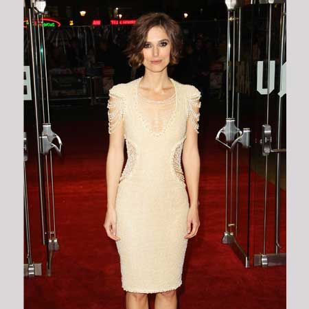 Keira glammed up for the UK premiere of Never Let Me Go wearing an elegant pearl beaded Chanel dress with black satin and wood platform shoes. Is this the best you've seen the star look for ages?  <br />