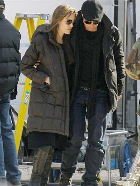 Brad Pitt and Angelina Jolie huddled together on the set of her new film and directorial debut in Budapest, Hungary...