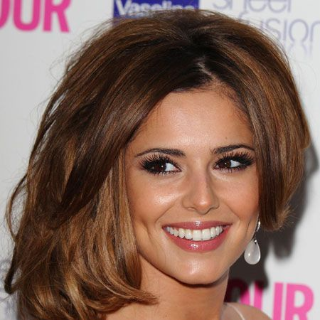 <p>Lots of lashes Cheryl knows the simple style rule&#x3B; if you go to town on your eyes keep your lips neutral. The X Factor judge opts for lots of falsies, a subtle bronzer and a flash of muted colour on the lips</p>