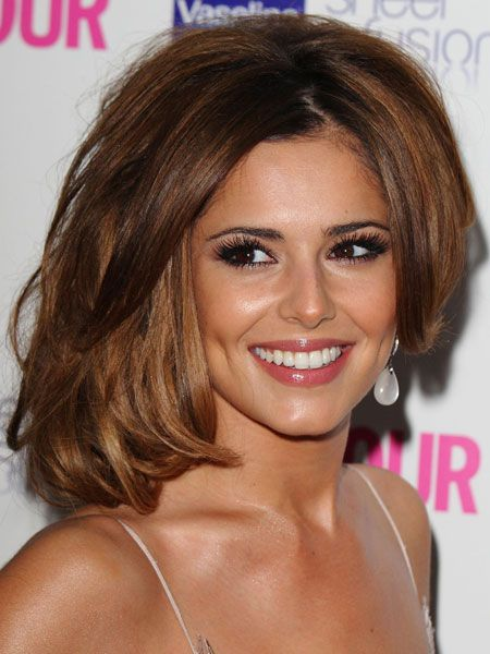 <p>Lots of lashes Cheryl knows the simple style rule; if you go to town on your eyes keep your lips neutral. The X Factor judge opts for lots of falsies, a subtle bronzer and a flash of muted colour on the lips</p>