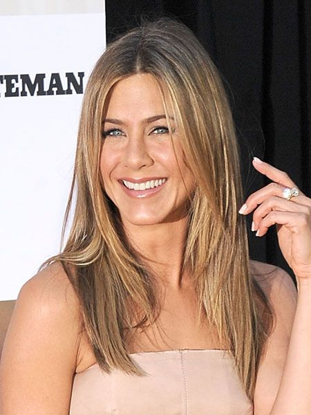 Get poker-straight hair like Jennifer Aniston's gorgeous locks with lots of heat defence serum, red hot straightening irons and a spritz of shine spray to finish. Easy to achieve but with an oh-so-sexy result