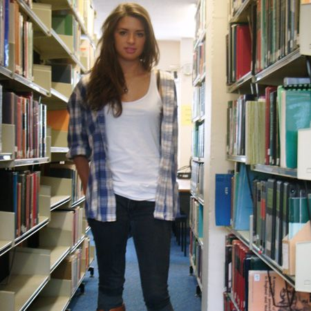 <p>Liz Smith is studying History and International Relations at Exeter and works a cool casual look in the library in jeans, vest top and open check shirt. Love those tan boots!</p>