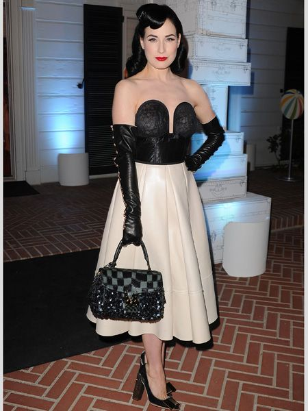 <p>With the explosion of Christina Hendricks on the celeb scene and the ever to-die-for dress style of Dita Von Teese, retro ladylike luxe is having a moment. Here are the hottest 50s fashionistas </p><p>Left: <strong>Dita</strong> does raunchy lady like no other! Her corset top, full circle skirt and bicep-high gloves are true glamour</p>