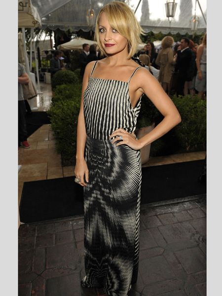 <h3>Nicole Richie</h3> <br /> Nicole Richie attended a fash bash in a monochrome, trippy printed dress with minimal accessories and this season's plum coloured pout. Are you a fan of her latest fashion direction or would you rather she brought bohemian back?