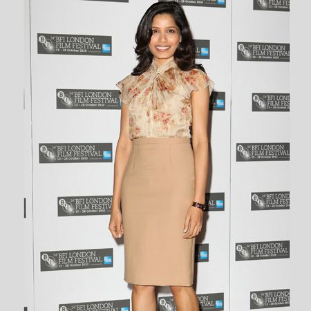 <h3>Frieda Pinto</h3><p>Frieda Pinto's been out and about promoting her new film 'Miral' and her latest outfit was this camel pencil skirt with a feminine blouse and cut out black pointy sandals. Do you like the way she's wearing this season's trends?</p>