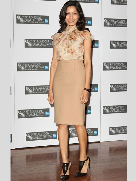 <h3>Frieda Pinto</h3>  <p>Frieda Pinto's been out and about promoting her new film 'Miral' and her latest outfit was this camel pencil skirt with a feminine blouse and cut out black pointy sandals. Do you like the way she's wearing this season's trends?</p>