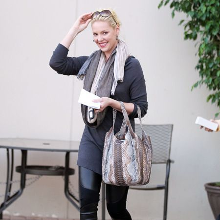 We know that Katherine Heigl is a busy working mum, but we're not sure if that's an excuse for this dubious outfit...PVC leggings paired with a snakeskin bag? She'd probably be better off if she lowered those shades back down and hid behind them. Sorry, Katherine, we love you normally!  <br />