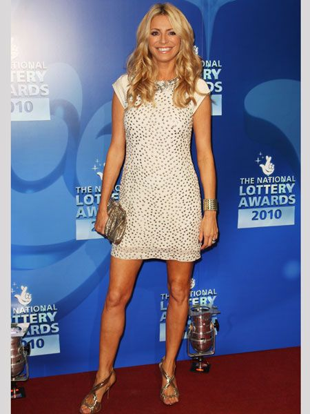 <p>Tess Daly chose a subtle take on the trend with this nude mini. The spaced out sequins look divine and she adds extra oomph with matching gold accessories </p>