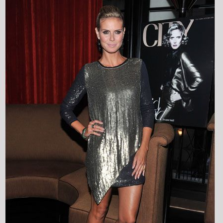 <p>Supermodel and super mum Heidi Klum stepped out in a draped number with metallic and black panels dripping in sequins. To add an extra kick she teamed her look with some neon strappy sandals...</p>
