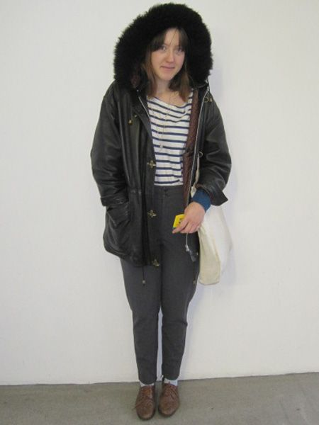 Gemma looks snug as a bug in a rug in her furry hooded parka<br />