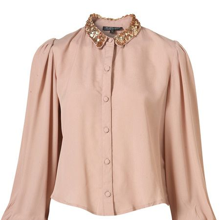 """Combat the cold blush on your cheeks that the winter brings with this beige sequin shirt. Perfect for bringing some Christmas spirit into the office <p> </p><p>£45, <a href=""""http://www.topshop.com/webapp/wcs/stores/servlet/ProductDisplay?beginIndex=0&viewAllFlag=&catalogId=33057&storeId=12556&productId=2112701&langId=-1&sort_field=Relevance&categoryId=208491&parent_categoryId=&sort_field=Relevance&pageSize=200"""" target=""""_blank"""">topshop.com</a></p>"""