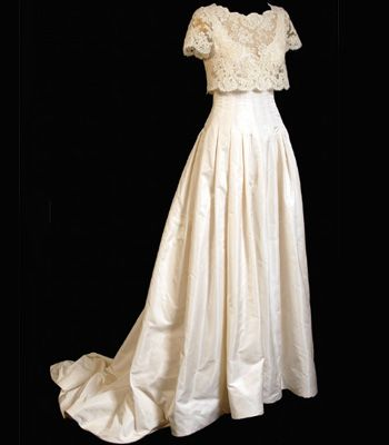 """<p><strong>Designer: Bruce Oldfield</strong> </p>  <p>The bookies' favourite to design the dress. Kate could go old fashioned in this poufy number with a lace overlay top</p>  <p>See more at <a href=""""http://www.bruceoldfield.com/"""" target=""""_blank"""">bruceoldfield.com</a></p>"""