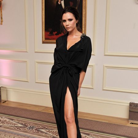 <p>At last night's uber glamorous British Fashion Awards VB nailed laidback luxe in one of her own creations&#x3B; a black dress with a crotch-high split and subtle shoulder embellishment. She paired it with classic patent pointy courts for a seriously slick look. Is there no longer any doubt that she's a fashion icon?</p>
