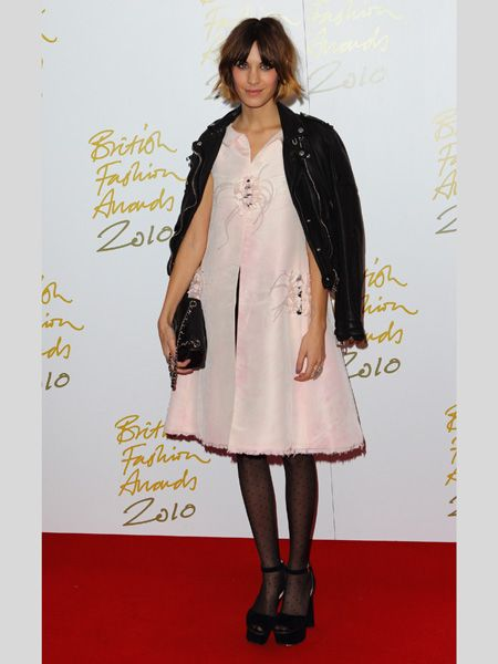 <p>Before picking up her British Style Award, Alexa posed in a puffy pink dress by Chanel teamed with spotty hosiery and block-heeled platforms. She kept her trusty biker jacket over her shoulders but whilst we like a fashion mash-up, the fusion of 50s ladylike and 90s grunge didn't quite work. Do you agree?</p>