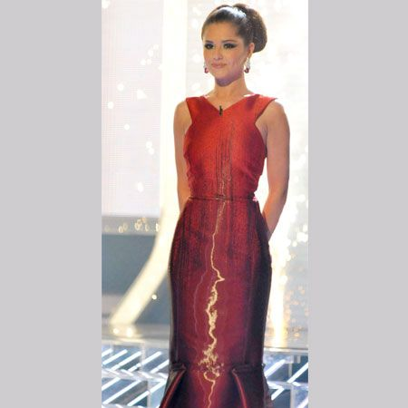 Striking a scarlet figure at the X Factor final was Cheryl Cole. The wet-look gown with fishtail hem hugged Chezza's figure in all the right places. <br />