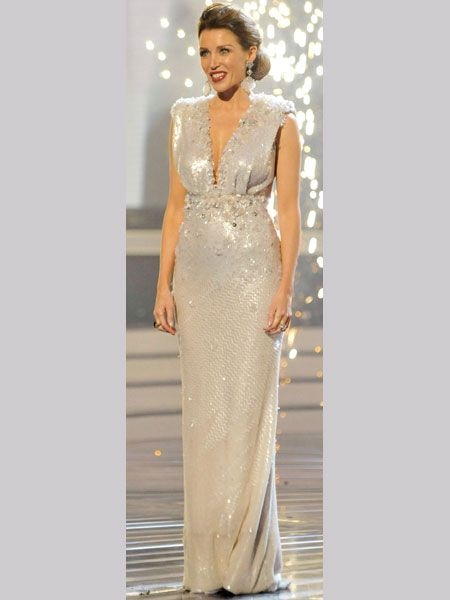 Dannii Minogue scored in the style stakes as well as having her act, Matt Cardle, bag  the big X Factor prize this weekend! Dannii shimmered in a glittering Jenny Packham creation which featured a daring slashed-to-the-waist neckline. Did you love Dannii's finale frock? Vote below!