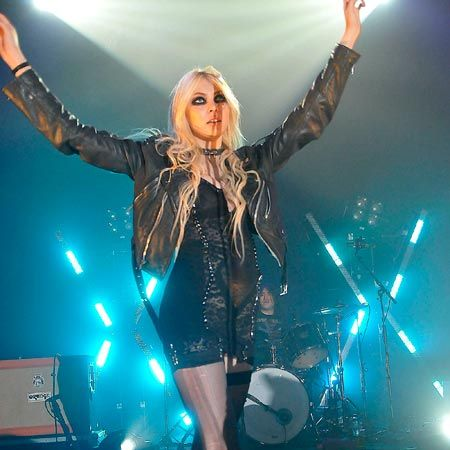 Taylor Momsen showed off her never-ending pins in a pair of laddered suspenders as she performed with her band The Pretty Reckless at the London O2 Shepherd's Bush Empire...  <br />
