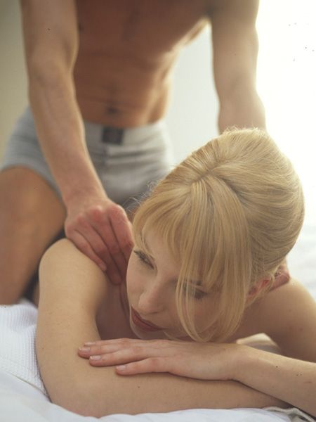 At the centre of the slopey bit at the base of your spine there is an indentation just above your bum that is very receptive to touch. Lie on your front on the bed and have him run his figners down your spine and then massage this indentation in a gentle circular motion to ramp up the foreplay.