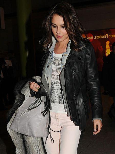 Cheryl casual at Heathrow in Jan 2010