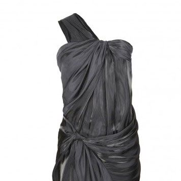 """<p>This charcoal beauty is the pefect party dress for anyone wishing to dress dark and the twisted fabric adds just enough drama without too much fuss. The one shoulder detail is just SO now</p><p> </p><p>£175, <a target=""""_blank"""" href=""""http://www.allsaints.com/women/dresses/jelan-dress/black/wdj111-5"""">allsaints.com </a><br /></p>"""