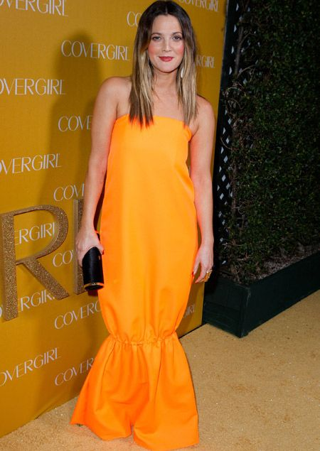 <p>Drew often causes controversy on the red carpet in her bold outfits and this vivid orange ensemble by Jil Sander is yet another look that's dividing opinions. Boasting a fishtail kick pleat and strapless neckline this is certainly a unique take on the trend but the tangerine shade is set to be super hot this season</p>