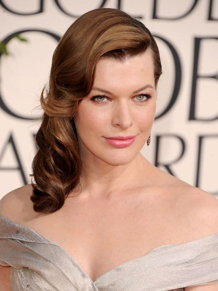 <p>Channelling 1940s waves, Milla Jovovich swept her hair to one side in a cleverly constructed mass of neatly coiffed curls. Wearing smoky brown eyeshadow and a rosehip lip to add to the old school glamour, she looks a picture of perfection</p>