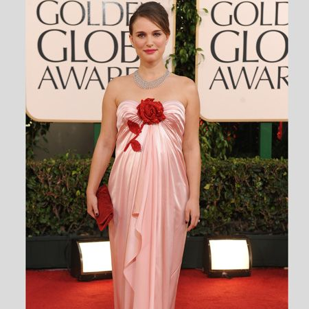 <p>Natalie won Best Actress and we think she deserves Best Dressed too for her Viktor & Rolf couture silk satin column gown with a hand-embroidered Swarovski crystal red rose. It looks bloomin' beautiful on the pregnant star. Bravo!</p>