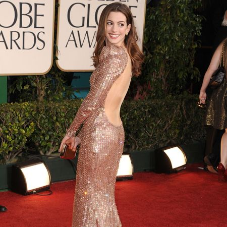 <p>Anne rocked one of the hottest trends of the night&#x3B; the backless gown. Hers, by Armani Privé, made of sparkling flesh hued crystals was a sure-fire hit </p>