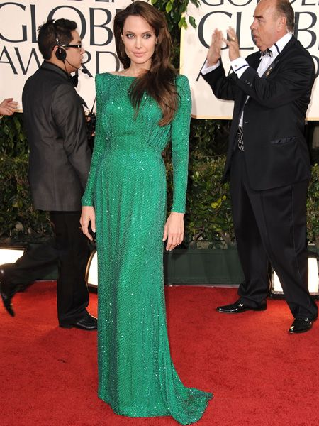 <p>Angelina also opted for shimmer in a Swarovski crystal-coated green gown by Versace that flashed little flesh </p>