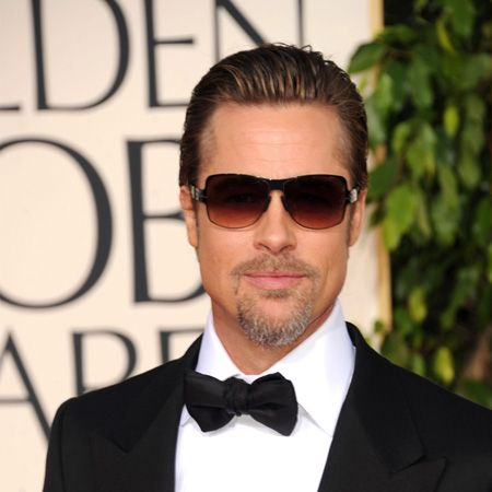 A suave Mr Pitt graces the red carpet at the Golden Globes looking every inch the superstar