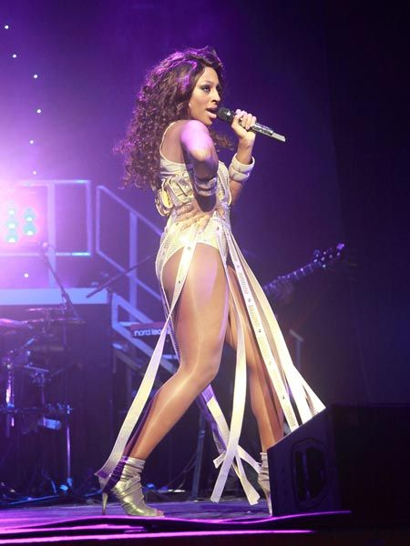 <p>Alexandra Burke showed off her super-toned body in a one-piece as she performed at the O2</p>