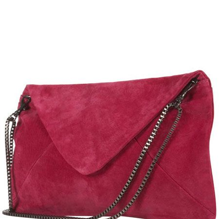 """<p>This little baby will prove red hot arm candy for your sweetheart this Valentine's day. The bold scarlet colour is bang on the bright trend and the practical strap turns the statement clutch into a dainty shoulder bag. Magic! </p><p>£40, <a target=""""_blank"""" href="""" http://www.topshop.com/webapp/wcs/stores/servlet/ProductDisplay?beginIndex=0&viewAllFlag=&catalogId=33057&storeId=12556&productId=2142387&langId=-1&categoryId=&searchTerm=suede%20cltuch&pageSize=20 """">topshop.com </a><br /></p>"""