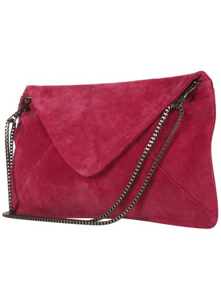 "<p>This little baby will prove red hot arm candy for your sweetheart this Valentine's day. The bold scarlet colour is bang on the bright trend and the practical strap turns the statement clutch into a dainty shoulder bag. Magic! </p>  <p>£40, <a target=""_blank"" href="" http://www.topshop.com/webapp/wcs/stores/servlet/ProductDisplay?beginIndex=0&viewAllFlag=&catalogId=33057&storeId=12556&productId=2142387&langId=-1&categoryId=&searchTerm=suede%20cltuch&pageSize=20 "">topshop.com </a><br /></p>"