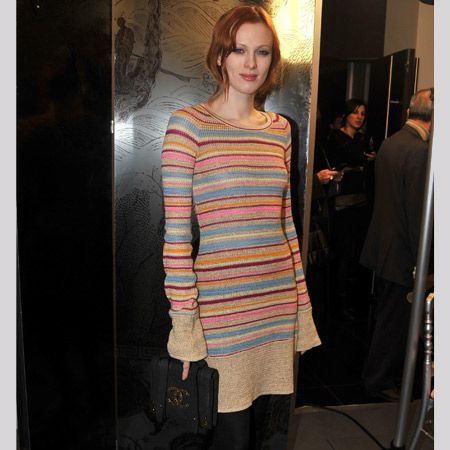 <p>Karen shows us mere mortals how to work the jumper dress trend at Paris Fashion Week. Wearing an oatmeal and pastel striped knit with black tights, heels and a cute Chanel bag dresses up the look and establishes her as a genuine style sweetheart. Is her snug as a bug style winning you over?</p>