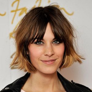 <p>Rarely seen without one, Alexa accessorises her centre parting with a short shaggy bob and feathered fringe</p>