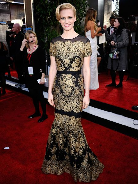 <p>The Mad Men star stood out in a vintage-esque gold and black Carolina Herrera dress which looked dramatic against her icy blonde hair and porcelain skin. Is this as good as her red hot Golden Globes gown?</p>