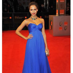 True blue! In a billowing electric blue gown by Versace, Jessica shone on the red carpet. Strapless, pleated and the perfect canvas to show off her tribal-style accessories -we're loving that rock of an emerald ring too!
