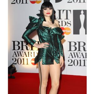 Jessie went all out in an architectural emerald green mini dress with statement hosiery and tasselled ankle boots