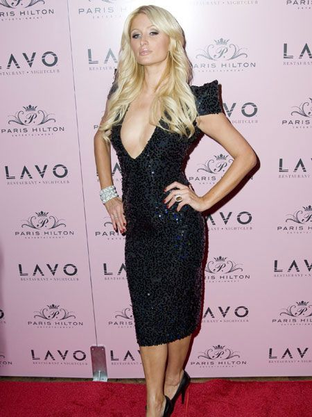 Socialite Paris Hilton celebrated one of many 30th birthday bashes to come in a sequinned black dress at exclusive New York club, Lavo.