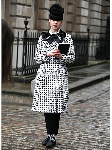 <p>This stylish lady looked anything but boring in an all black and white ensemble – we love the patterned socks peeping out from below her trousers, not to mention the pop of blue on her lips!</p>