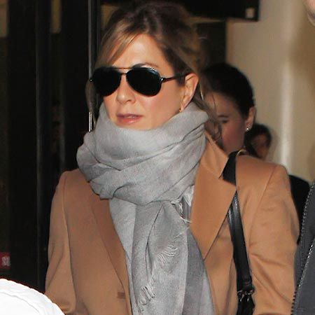 Jennifer Aniston was spotted arriving back at LAX after European promotional work for her Adam Sandler comedy, Just Go With It.