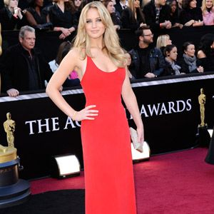 <p>One of the first to arrive on the red carpet, Jennifer Lawrence who is nominated for Best Actress for her performance in Winter's Bone, wore a scarlet Calvin Klein dress, Jimmy Choo platforms and a bag by Judith Leiber. Hot stuff! </p>