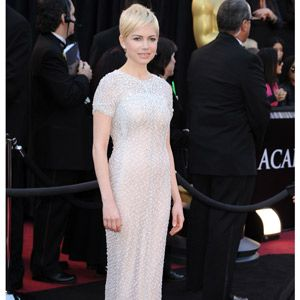 <p>Sparkling in a white sequined Chanel dress with capped sleeves, Michelle Williams completed her Oscar 2011 outfit with a pair of trusty Jimmy Choos</p>