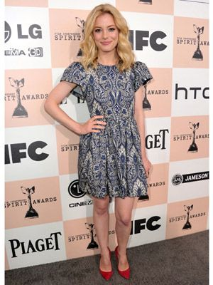 Looking every inch the cute fashionista at the Women in Film party on Friday, the actress rocked a 50s-themed look with lollypop red heels and a kaleidoscope print blue dress