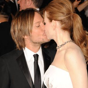 <p>Nicole Kidman and hubby Keith Urban locked lips for the awaiting paps. It's the first time the actress has been up for an Oscar as Mrs Urban, an experienece she said she's always wanted to share with him</p>
