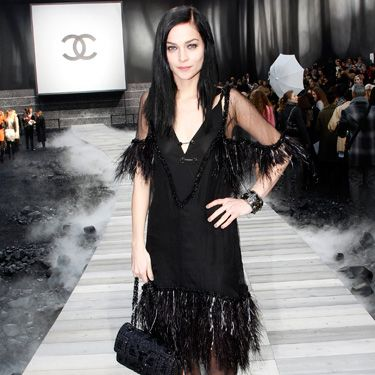 <p>The model-DJ also wore a look from the current Chanel collection at their AW11 show, a stunning feathered trimmed black dress</p>