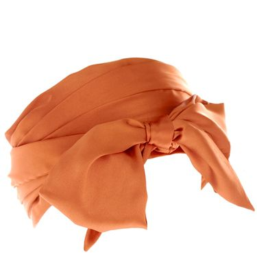 """<p>Wrap your head around this beauty for spring. The orange satin bow will add a zesty detail to your wardrobe</p><p>£12, <a href=""""http://www.asos.com/Asos/Asos-Wide-Headband-Scarf/Prod/pgeproduct.aspx?iid=1480419&cid=4174&sh=0&pge=2&pgesize=20&sort=-1&clr=Tobacco""""target=""""_blank""""> asos.com </a></p>"""