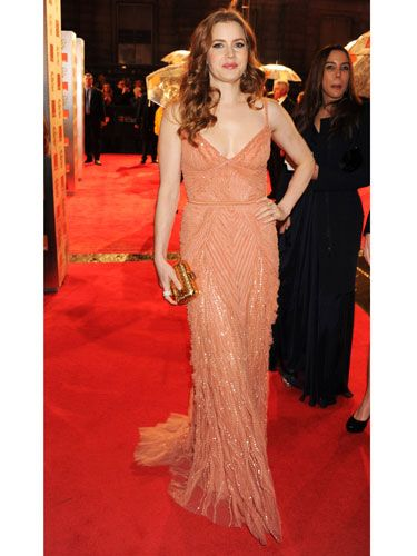 <p>Amy Adams opted for a beaded coral number at the BAFTAs, resembling a 20s screen queen. She paired her delicate dress with soft curls, a small gold clutch and natural make-up for a look that was positively romantic</p>